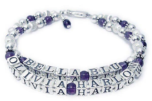 DBL-Gem-Ame1-2string  This is a 2 string bracelet with 4 names with a lobster claw clasp. The first string says Bella Blu and the second string says Olivia Harlow. They picked Amethyst Birthstones and added an Amethyst Birthstone charm.