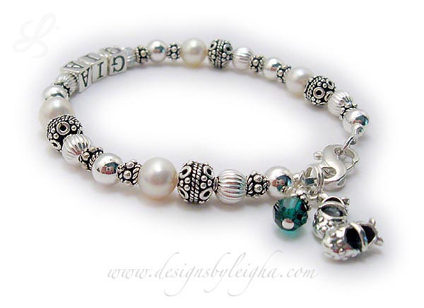 'DBL-PS1-1 string Enter: GIA  This is a 1 name Pearl and Sterling Silver Mothers Name Bracelet with GIA. They added a birthstone crystal dangle (May or Emerald) and chose one of my free lobster claw clasps and added a Girl Bootie charm.