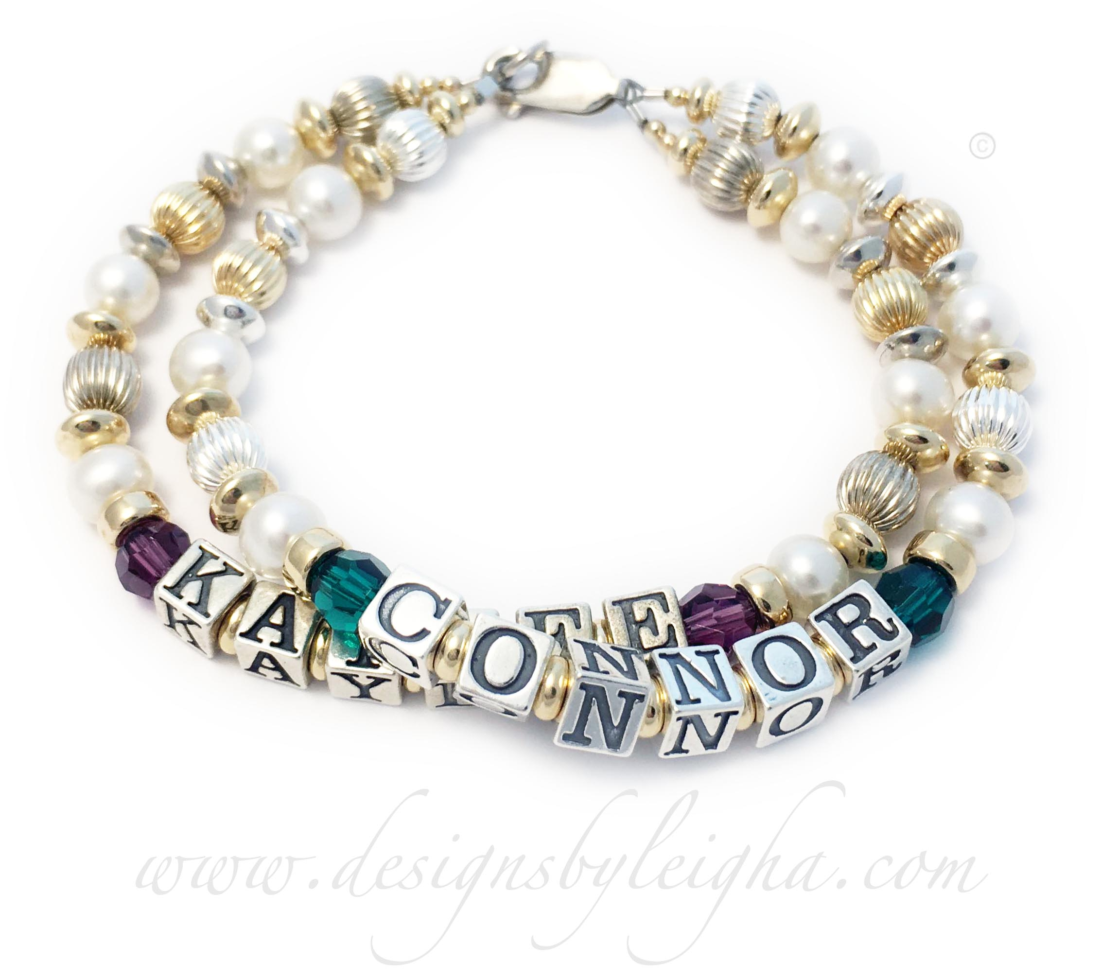 DBL-G9 - 2 string bracelet with 2 kids' names and birthstones Enter: CONNOR/May KAYLEE/Feb - Round They put CONNOR and May or Emerald Birthstone Crystals and the second string is KAYLEE with February Birthstone Crystals on their Pearl Bracelet for Mommy.