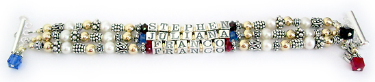 This is a 3-string Pearl, Bali and Gold Mother Bracelet with 3 kids names: Stephen with January or Garnet Birthstone Crystals before and after his name, Juliana with September or Sapphire Swarovski Birthstone Crystals before and after her name and Franco with July or Ruby Swarovski Birthstone Crystals before and after his name. They also added a MOM charm and 3 Birthstone Crystal Dangles: Garnet, Sapphire and Ruby.