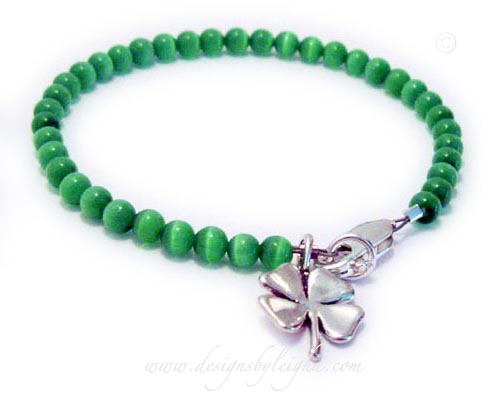 Luck of the Irish Bracelet comes with a Shamrock Charm - Cat's Eye Beads come in 14 colors - Dark Blue, Light BLue, Dark Green, Light Green, Dark Orange, Light Orange, Yellow, Lavender, Violet, White, Pink, Dark Grey, Light Grey.