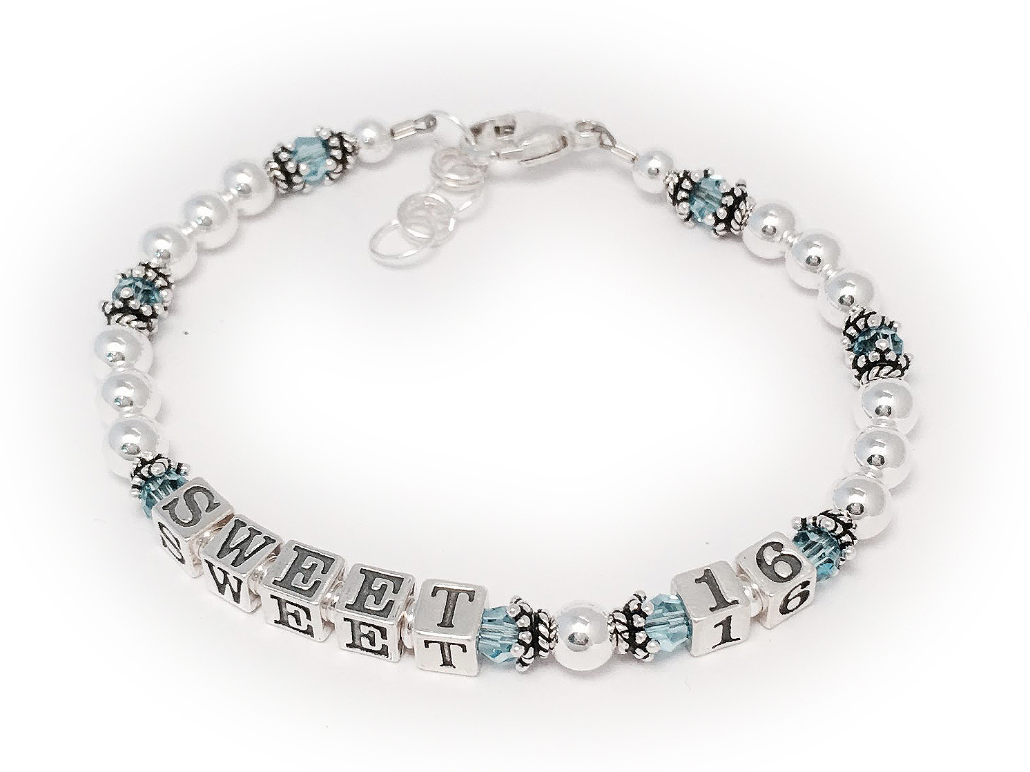 DBL-MB-4  Sweet 16 Bracelet with March or Aquamarine Birthstones  This Sweet 16 Bracelet is shown with March or Aquamarine Birthstone Colored Swarovski Crystals. They added a lobster clasp with an extension so it was sure to fit. That is an option in the Clasp drown-down menu.