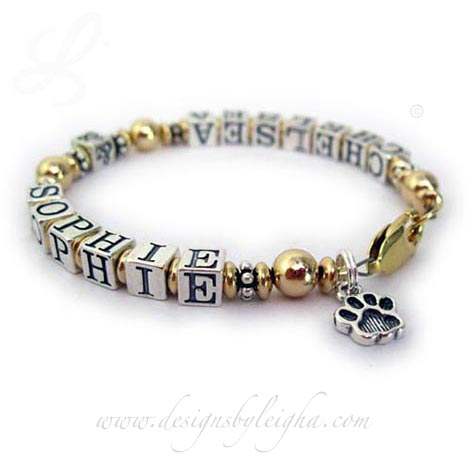 DBL-AR-G5Fur Baby Name BraceletEnter: Chelsea & SophieThis is a gold and sterling silver Fur Baby Name Bracelet with Chelsea and Sophie and they added a Paw Print charm. They picked the 14k gold-plated lobster claw clasp.