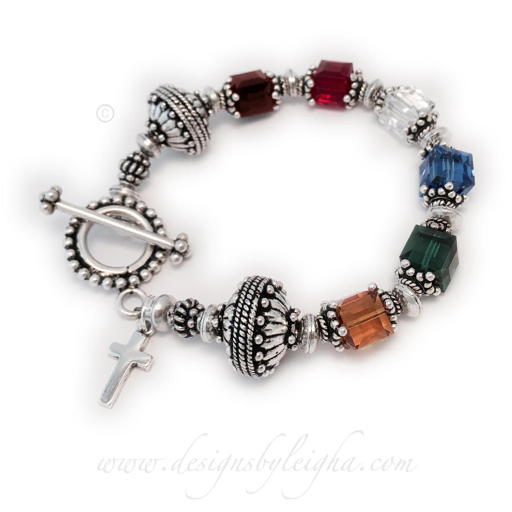 This Bali Birthstone Bracelet is shown with 6 birthstones (January, July, April, Septtember, May and November). They added a Simple Cross Charm and upgraded to the Beaded Toggle Clasp.