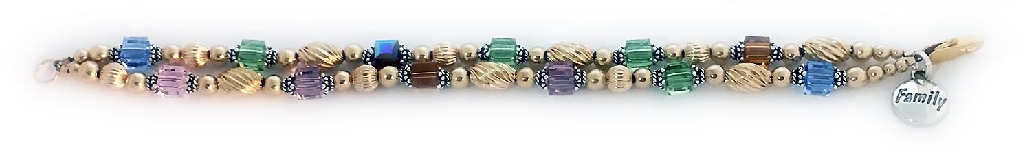 This Gold Swirl Birthstone Bracelet is shown with 12 Swarovski Crystal Square Birthstones :1st string: November, August, August, January, August, December 2nd string: October, June, November, June, August, December. They also added a FAMILY Charm to their order.