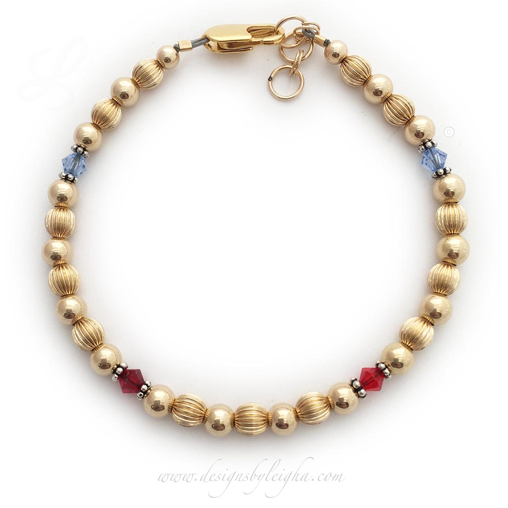 Shown with 4 Birthstones: December or Blue Topaz, January or Garnet, July or Ruby and another December or Blue Topaz. They added a 14k gold-plated lobster claw clasp with an extension.