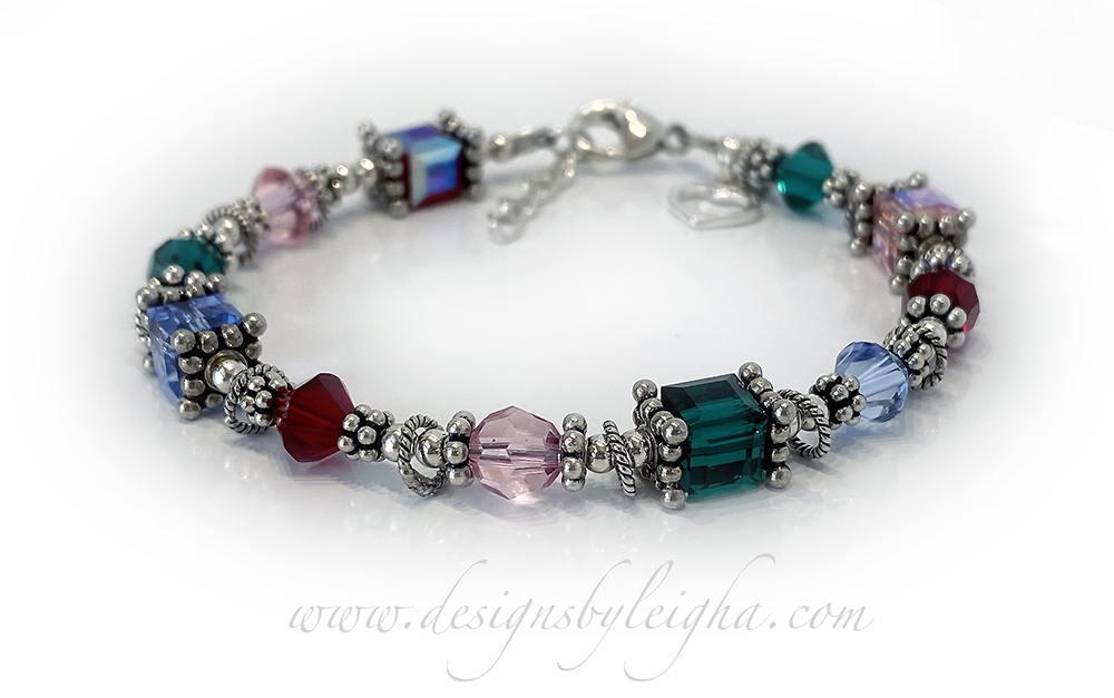 DBL-Birthstone-Bracelet-12   This Birthstone Bracelet is shown with 11 crystals representing 4 different birth months; Ruby or July, October or Opal, May or Emerald and Topaz or December.