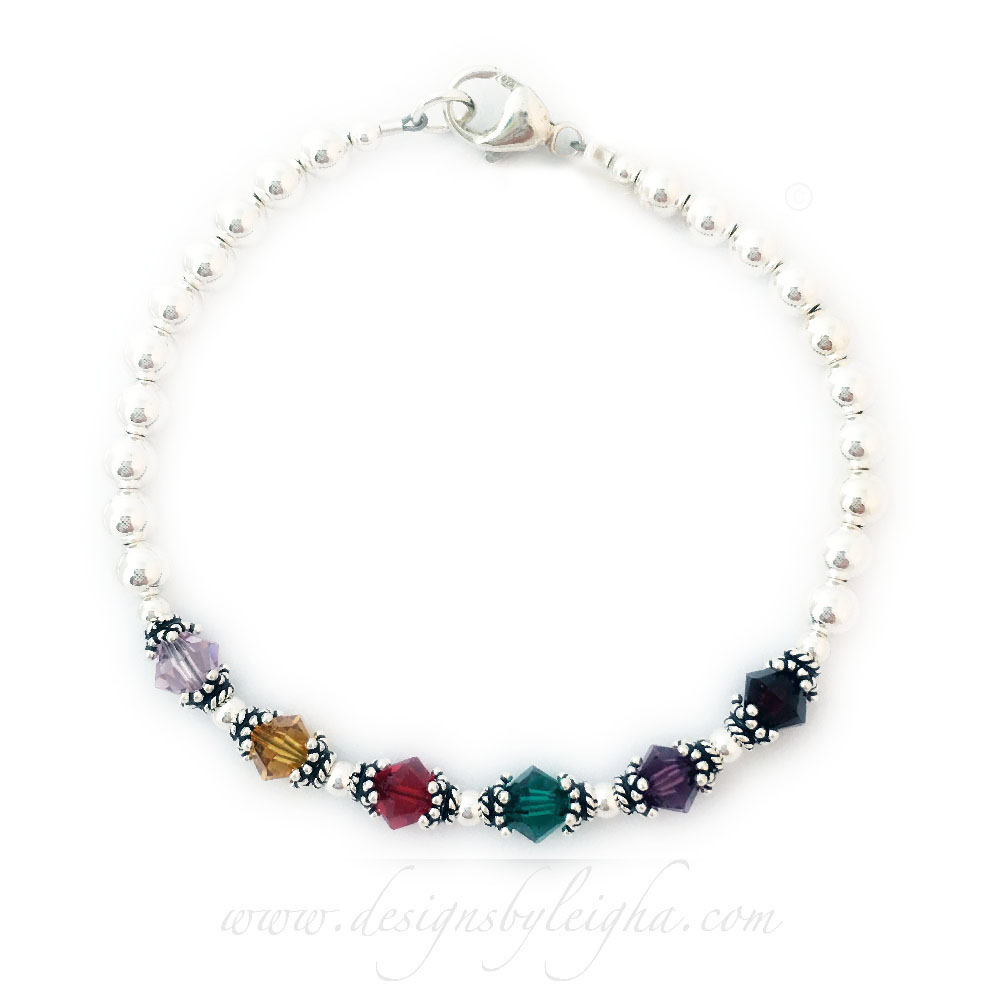 This is a 6 Birthstone Bracelet shown with a lobster claw clasp and they added a charm: Small Puffed Heart. June, November, July, May, February and January are shown.