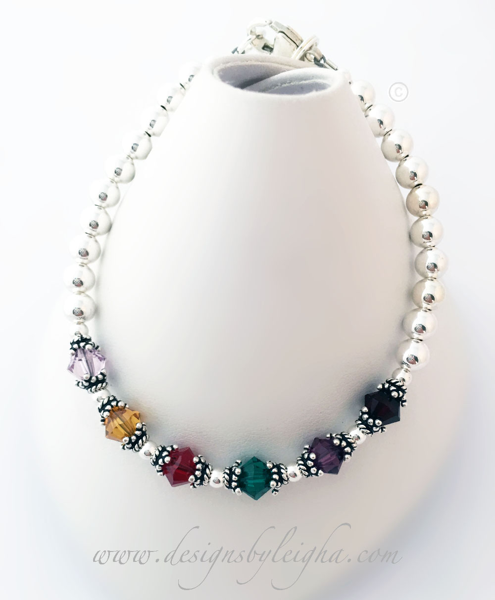This is a 6 Birthstone Bracelet shown: June, November, July, May, February and January are shown (Violet, Golden Topaz, Ruby, Emerald, Amethyst and Garnet).