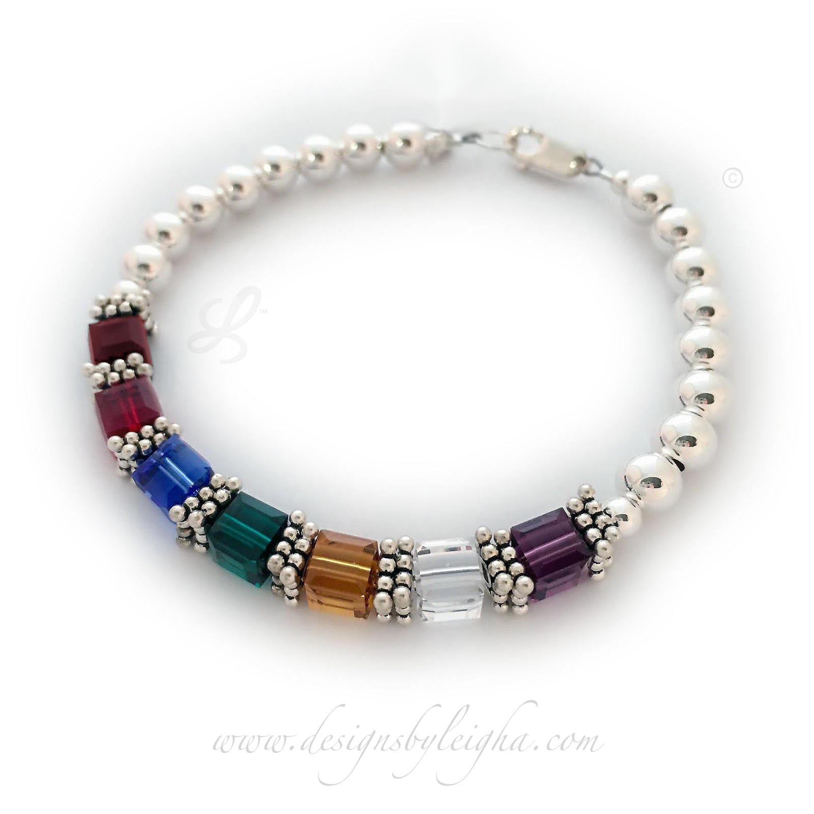 DBL-BB-Sal3  Shown with 7 birthstones and an add-on Fancy Cross Charm. January, July, September, May, November, April and February Birthstones are shown on this bracelet.