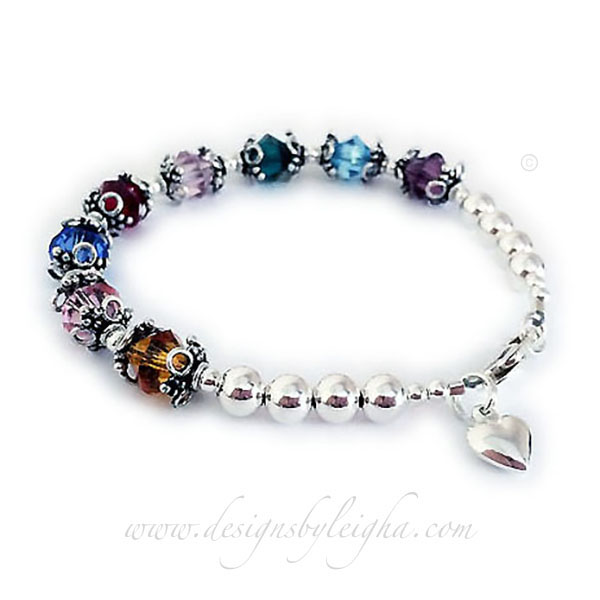 Shown with 8 birthstones - Amethyst or February, Aquamarine or March, Emerald or May, June or Light Purple, January or Garnet, Sapphire or September, October or Opal, Topaz or November. They added a Puffed Heart charm.