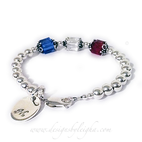 "DBL-BB-1-8mm-Square  Shown with 3 birthstones - September or Sapphire, April or Diamond and Ruby or July. They added an Oval Engravable Charm and I added the Curly Initial ""M"" it for free."