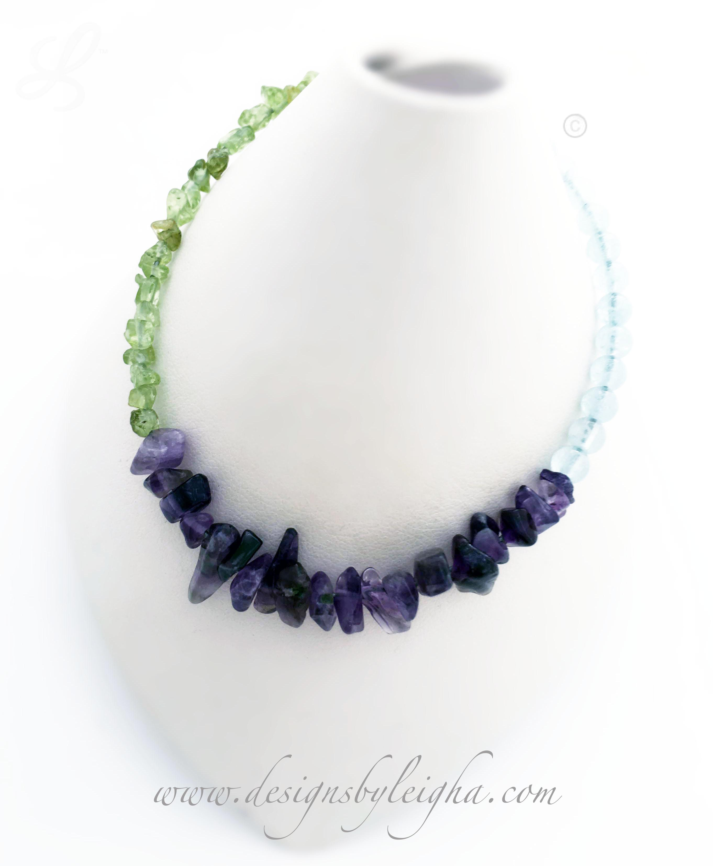 DBL-BB-19  This is a real gemstone bracelet with Amethyst, Aquamarine and Peridot beads.