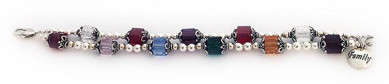 This is a 2-string bracelet with 8mm square or cube Swarovski crystals. They added a FAMILY charm and a Heart Lobster claw clasp. The first string shown has April or Diamong, July or Ruby, February or Amethyst, July or Ruby and April or Diamond. The second string shown has Garnet or January, Light Purple or June, Blue Topaz or December, Emerald or May, Golden Topaz or November and January or Garnet.