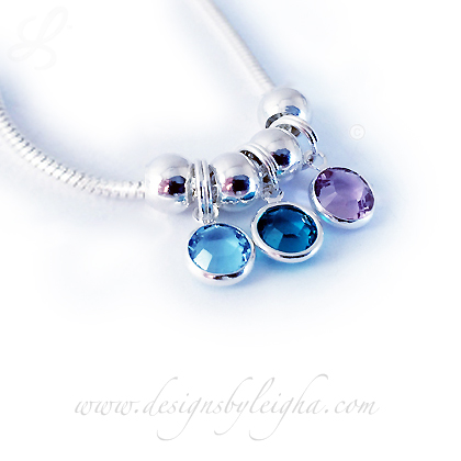 This Birthstone Charm Necklace is shown with 3 Swarovski Birthstone Charms: March or Aquamarine, December or Blue Zircon and June or Light Amethyst Birthstone Charms by Swarovski.
