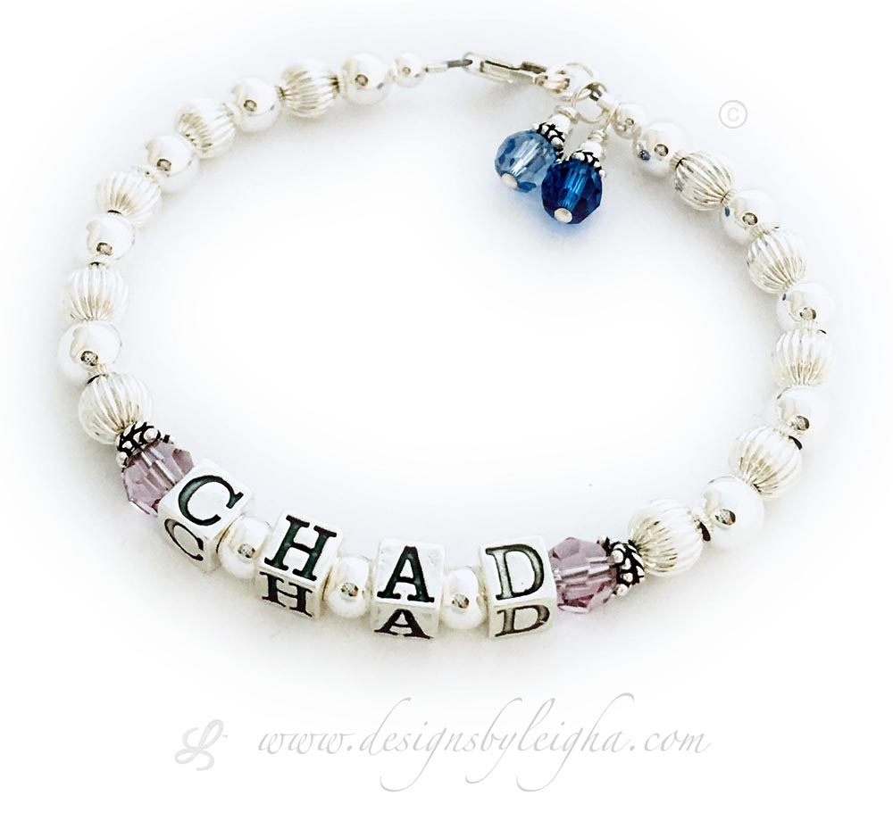 This is a 1-string DBL-SS1 1-String Bracelet with CHAD shown and June Birthstone Crystals. They added 2 Birthstone Crystal Dangles: September or Sapphire and December or Blue Topaz.
