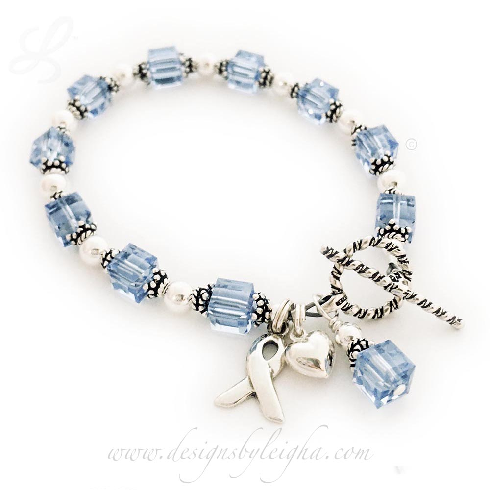 DBL-BB-17 with 3 add-on charms. Blue Topaz Birthtone Bracelet with 3 add-on charms: Ribbon Charm, Puffed Heart Charm and a Birthstone Crystal Dangle - $99 as shown.