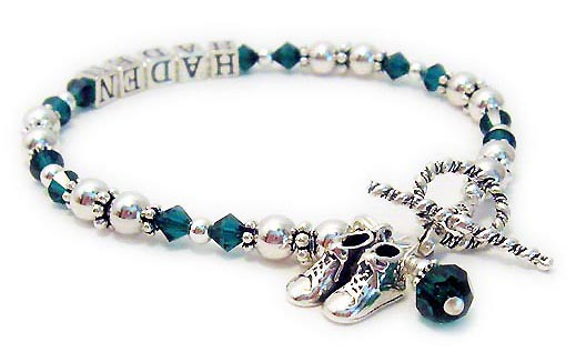 DBL-C1-1	String Bracelet Enter: HADEN/May They added 2 charms: Baby Boy Booties and a May Birthstone Crystal Dangle Charm.