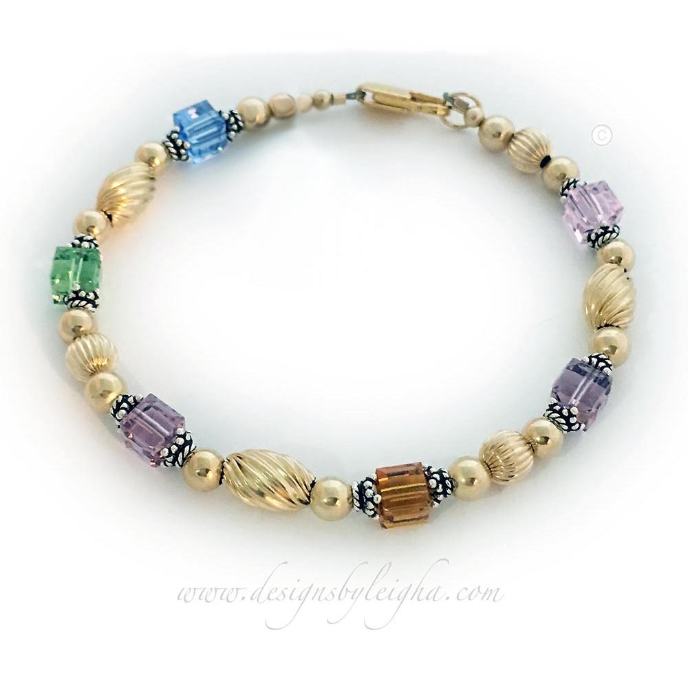 This Gold Swirl Birthstone Bracelet is shown with 6 Swarovski Crystal Square Birthstonese: October, June, November, June, August, December and an optional charm: FAMILY CHARM.