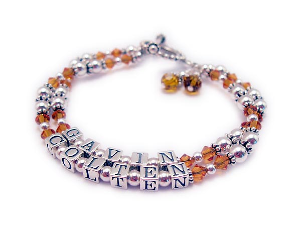 They added 2 November or Topaz Swarovski Birthstone Crystals and a Beaded Toggle Clasp. The names shown are Gavin and Colten.