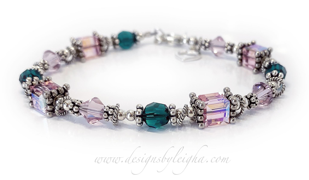 DBL-Birthstone-Bracelet-12   This Birthstone Bracelet is shown with 12 crystals representing 3 birth months; June or Alexandrite, May or Emerald and October or Pink / Opal.