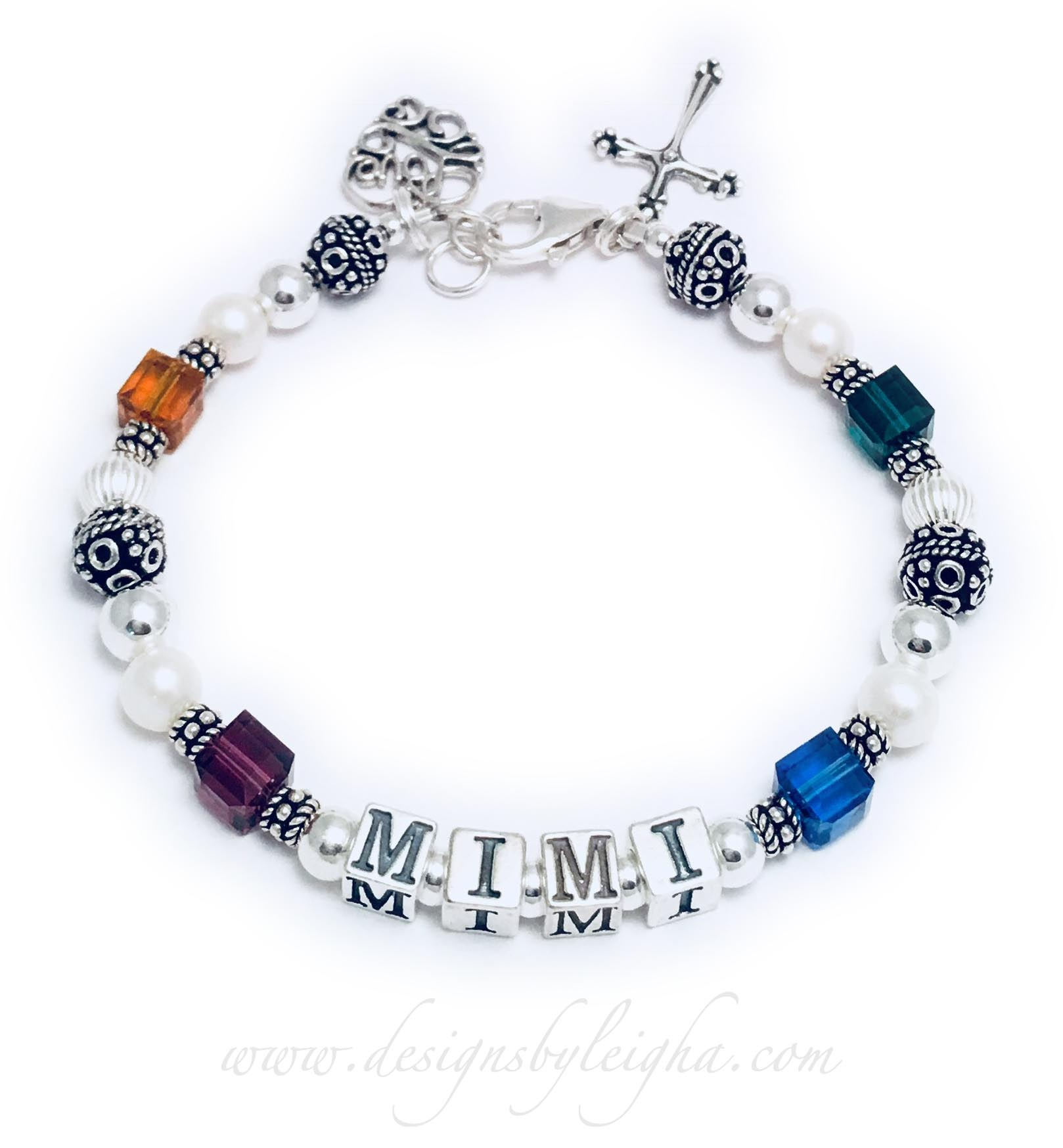 This is a 1-string MIMI Bracelet with 4 birthstones for her grandkids. Shown with a lobster claw clasp. They added 2 charms to their order: Filigree Charm and Fancy Cross Charm.