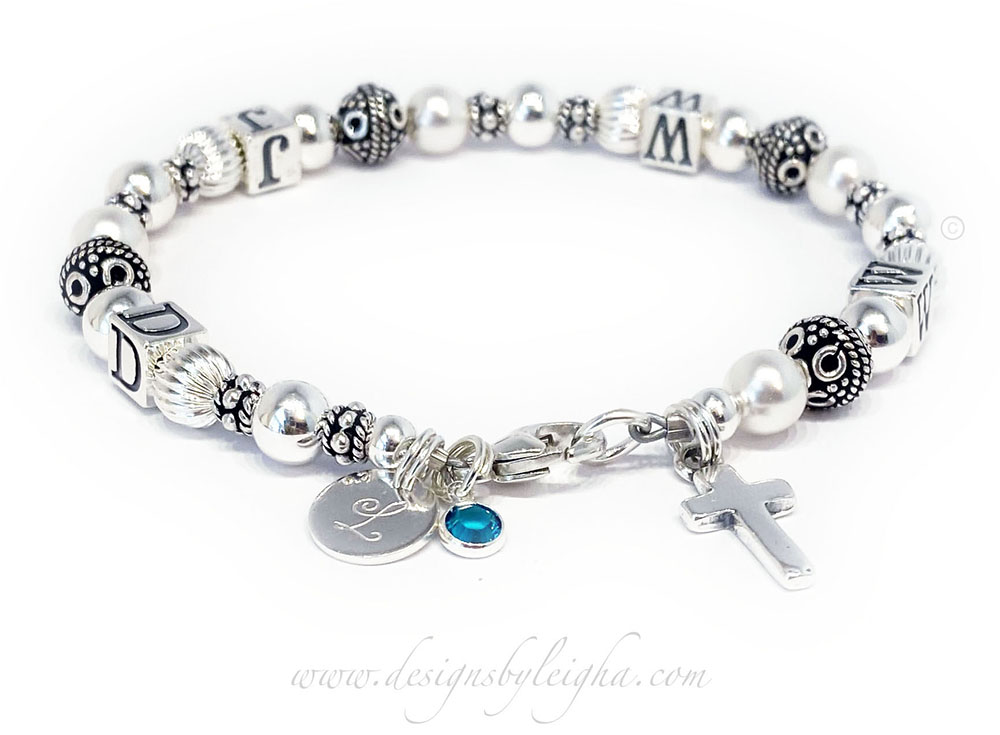 This Sterling Silver WWJD Bracelet is shown with 3 add-ons: Simple Cross Charm, Monogram Initial Charm and a Birthstone Crystal Dangle Charm.