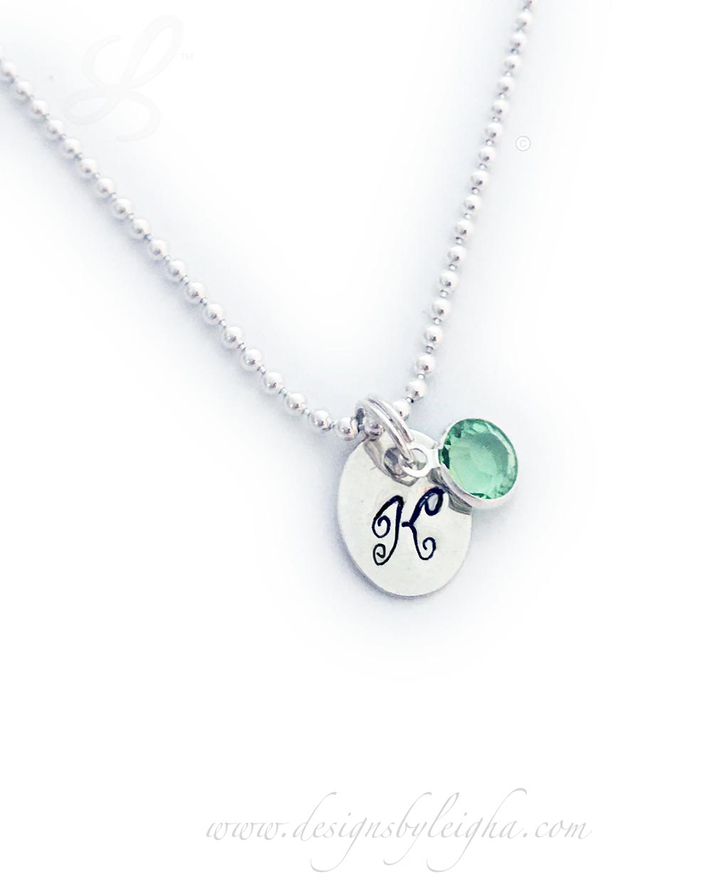 Initial Charm Necklace with a Birthstone - K and August Birthstone is shown on a Ball Chain Necklace