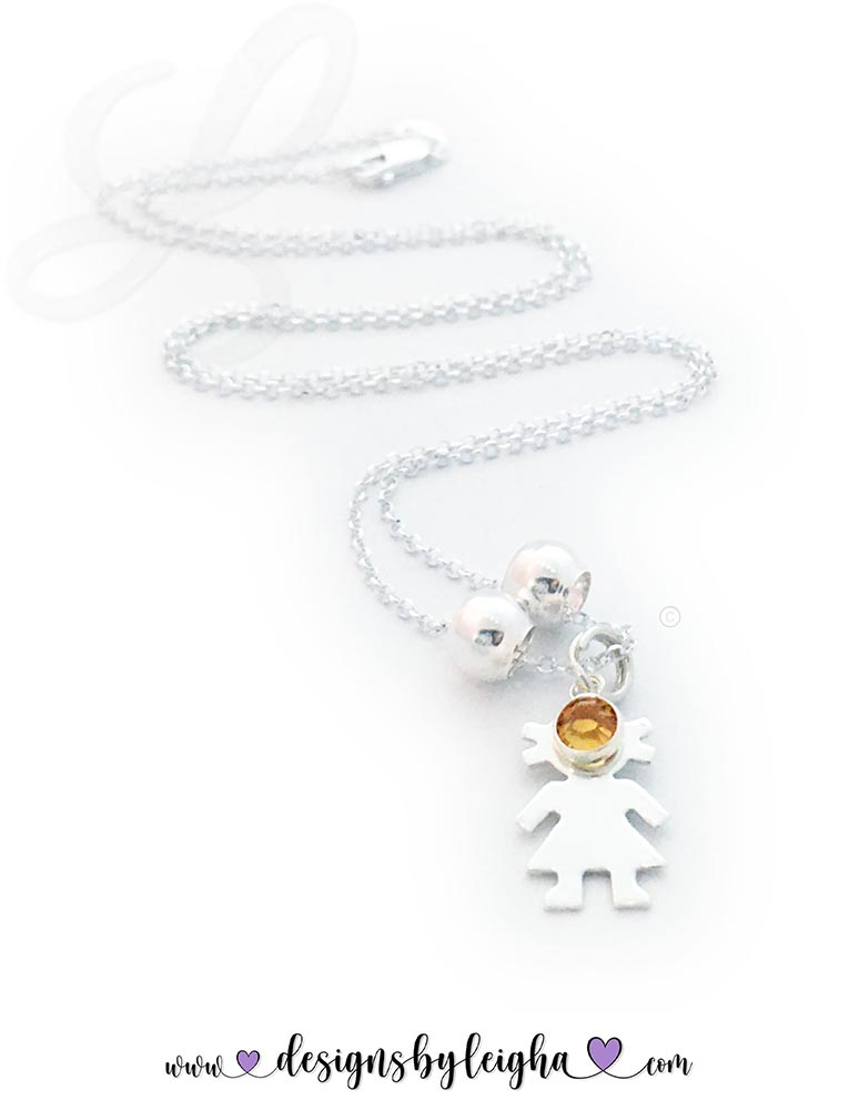 This is a 1 Girl Charm Necklace shown with 1 birthstone crystals - November or Topaz Birthstone.