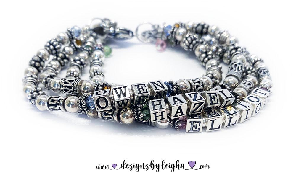 Owen, Cecilia, Hazel & Elliot Birthstone and Charm Mothers BraceletBirthstone and Charms shown... Tree of Life Charm, Simple Cross Charm, Peace Sign Charm, Family Charm, Beaded Heart Charm, November Birthstones, October Birthstone, August Birthstones, December Birthstones, Light Sapphire, Topaz, Opal and PeridotLink: https://designsbyleigha.com/silver7order4string.html#4-kids-names