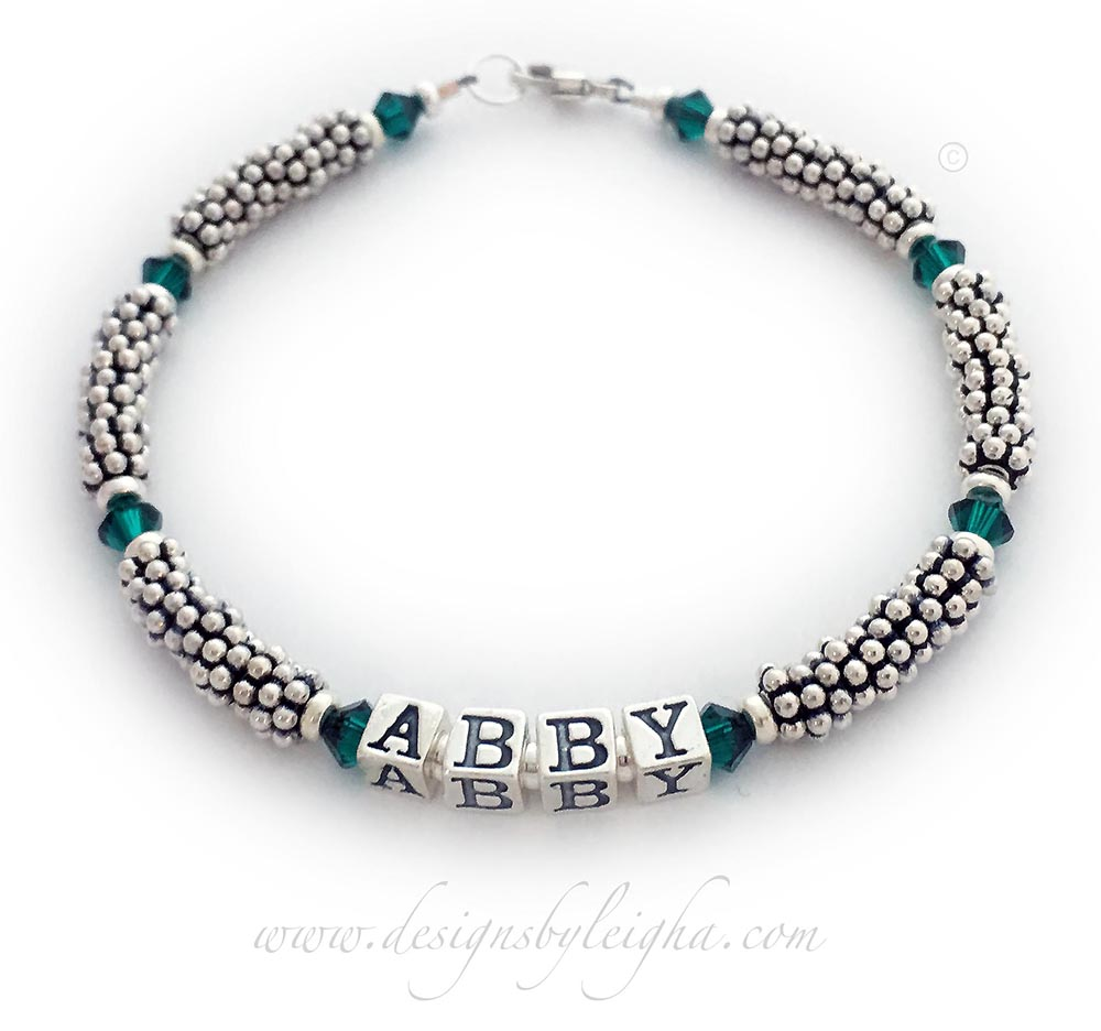 This is a rope style Birthstone Name Bracelet for Mommy or Grandma. A 1-string bracelet is shown with ABBY and May or Emerald 4mm Swarovski Birthstone Crystals.