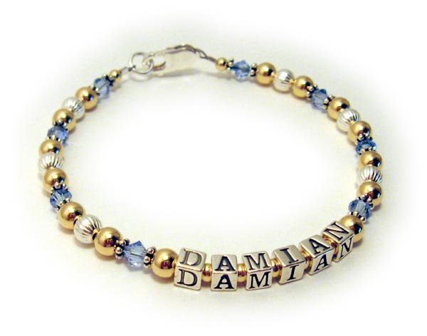 Gold mothers bracelet with December birthstone crystals Damien Bracelet