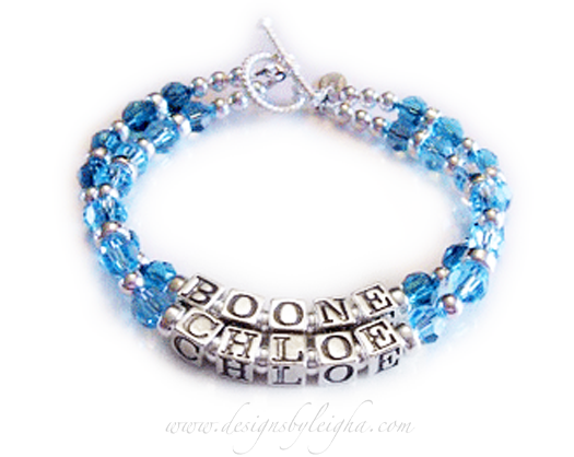 This is a 2-string 2 name bracelet with Boone & Chloe. This birthstone bracelet has December (blue Topaz) and March (Aquamarine) Birthstone Crystals.