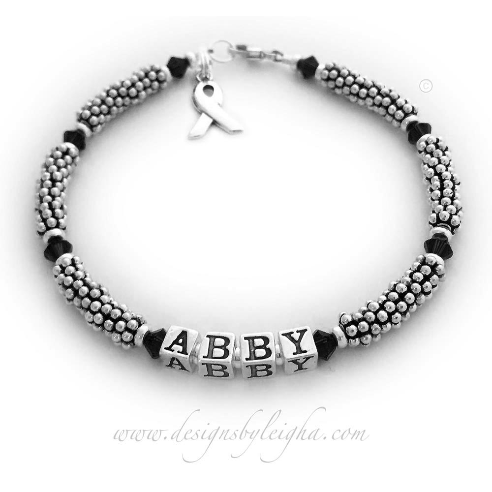 This is a 1-string Black Ribbon 5mm Rope Bracelet with a Ribbon Charm and a Lobster Claw Clasp. The Sterling Silver Rope Chain Beads and Black Swarovski Crystals are 4mm.