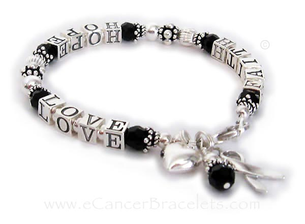 Melanoma Awareness Ribbon Bracelet with Faith Hope and Love written on it and they added a puffed heart charm.