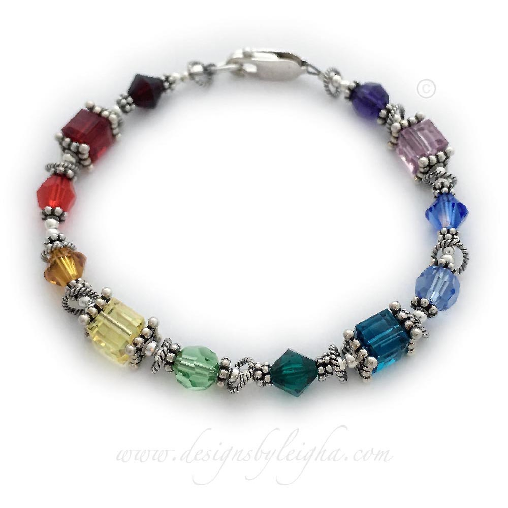 This 6mm Swarovski Crystal Birthstone Bracelet™ is made with 6mm bicone, round and or square Swarovski Birthstone Crystals. Each color represents the birth months of her grandchildren and surrounded by beautiful sterling silver beads and a sterling silver Lobster Claw Clasp.