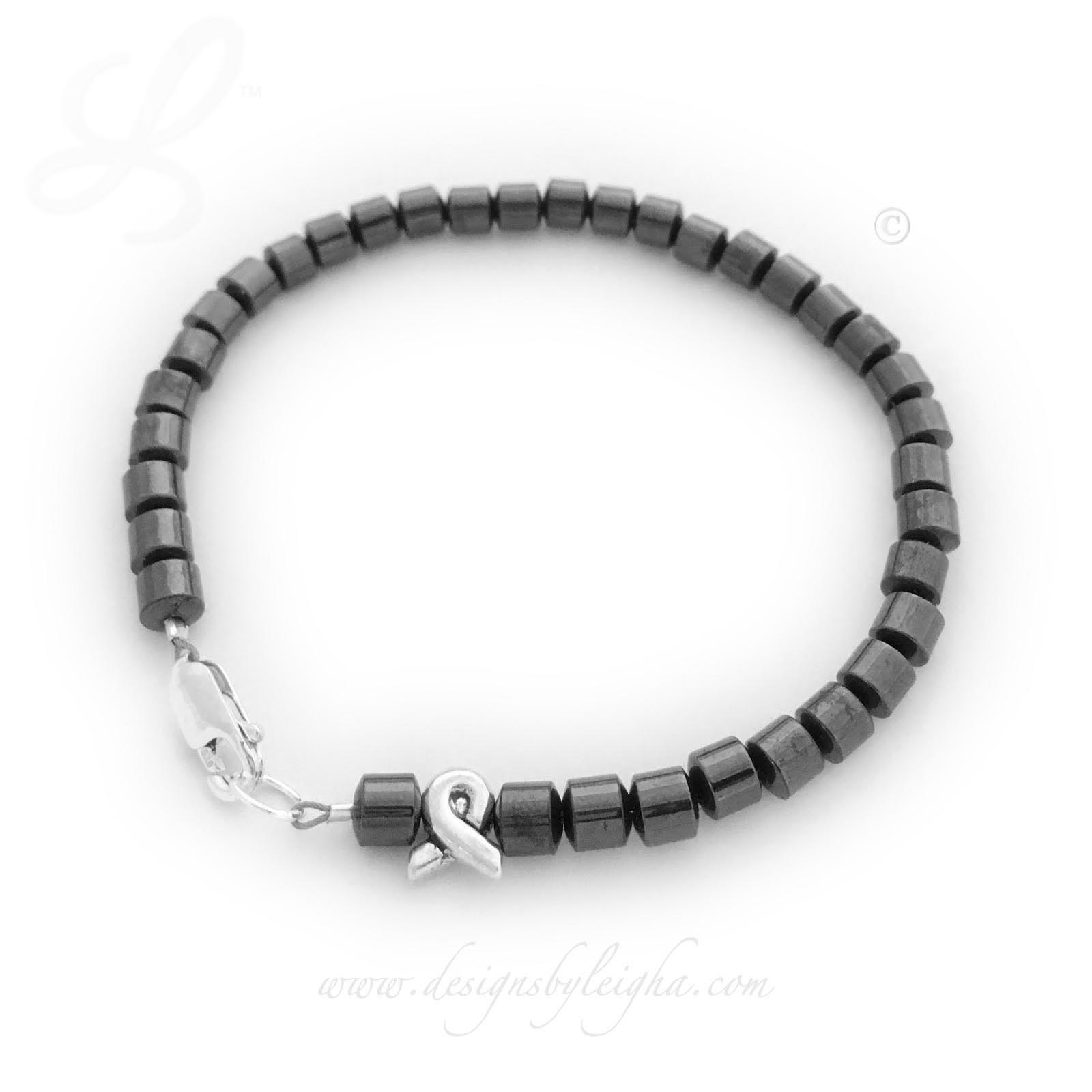 Magnetic Cancer Ribbon Bracelet shown with a sterling silver ribbon bead and sterling silver clasp.
