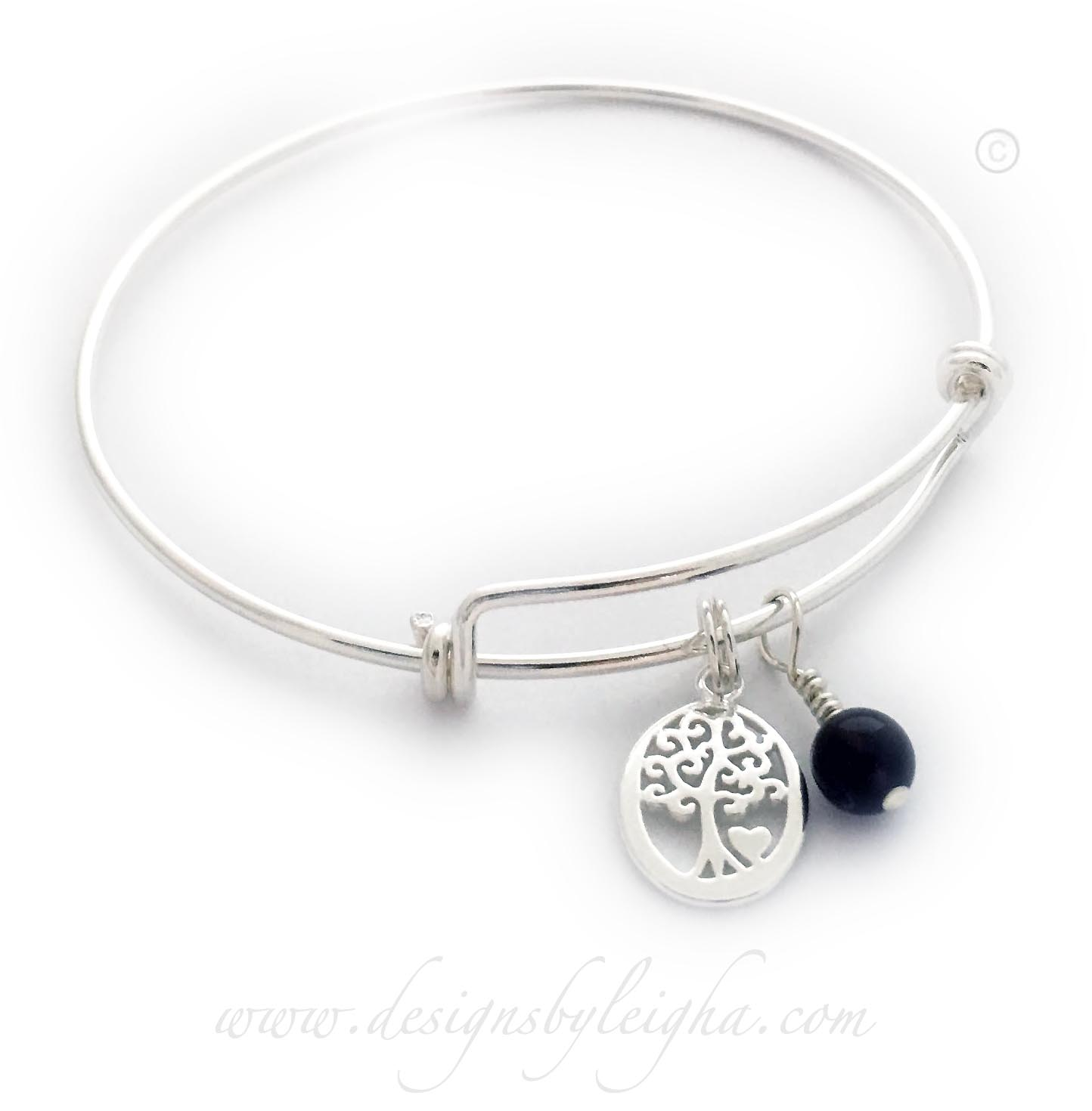 Tree of Life Charm Bracelet  DBL-Bangle-1  This Tree of Life Charm Bracelet comes with the Tree of Life charm. They added an Amethyst Birthstone Charm to their order.