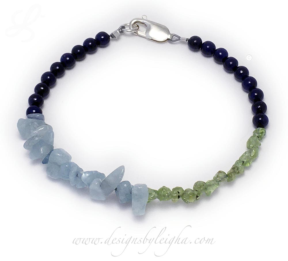 DBL-BB-19This Sapphire Riverstone, Aquamarine and Peridot bracelet is shown with a Lobster Claw Clasp.Enter: Sep-Mar-Aug-Sep