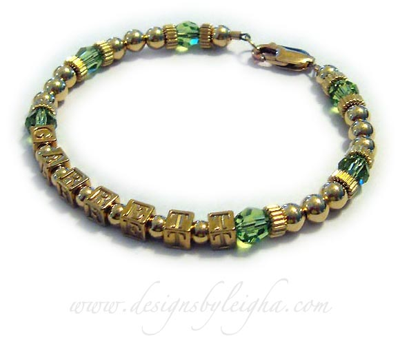 One-string Gold Block Mother Bracelet (DBL-GG2) with 1 name (GARRETT) and August or Peridot Birthstone 6mm Swarovski crystals. They picked the Gold Lobster Claw Clasp.