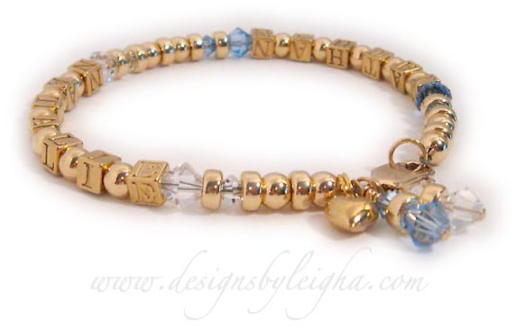 This Gold Block Mothers Bracelet is shown with 2 names (Nathan and Natalie) and December (Blue Topaz) and April (Diamond) Birthstone Crystals.  It is also shown with 2 Birthstone Crystal Dangle add-ons and an add-on Gold Puffed Heart charm.