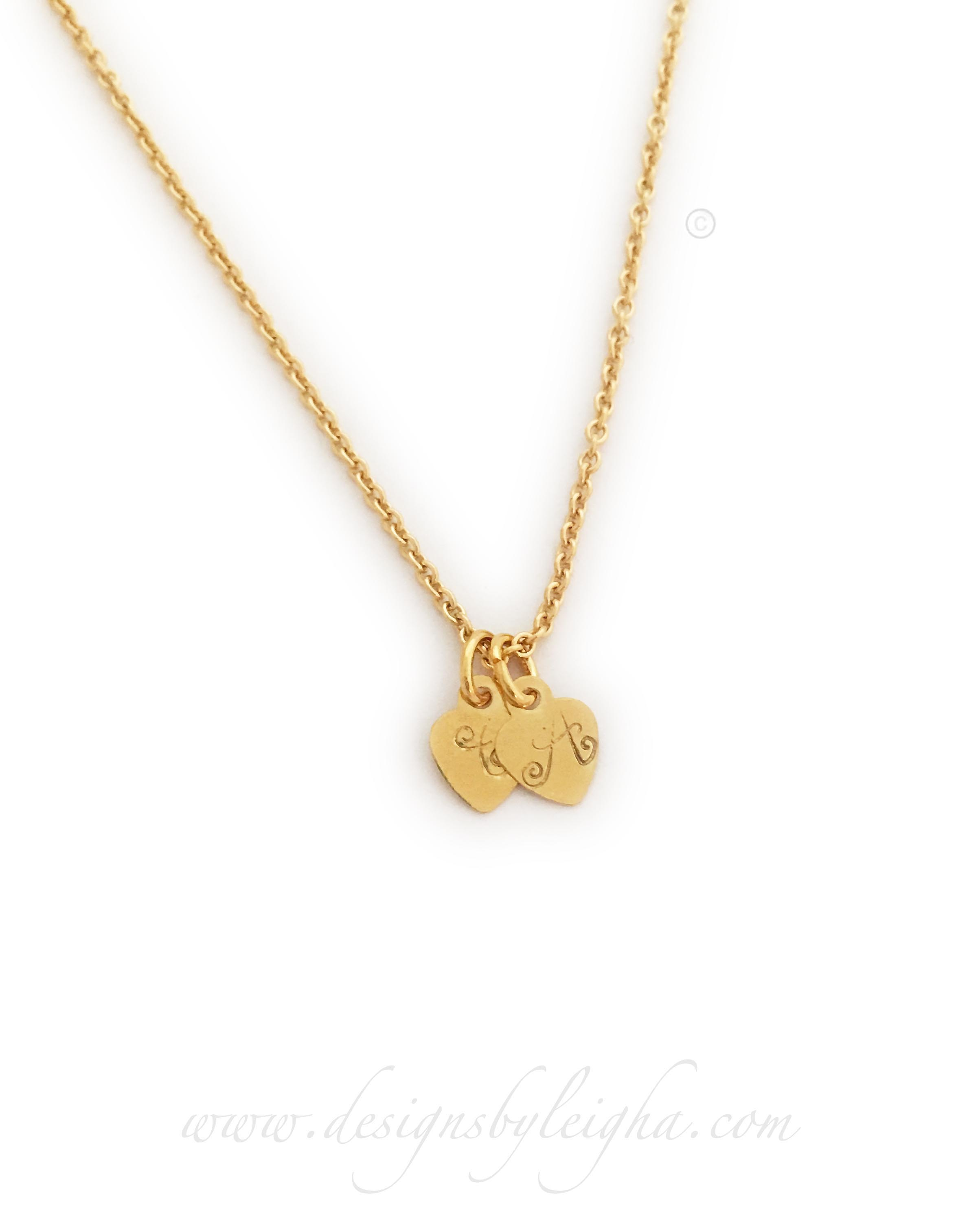 "This Gold Heart Necklace is shown with 2 gold heart initial charms: C and A on an 18"" gold-plated rolo chain."