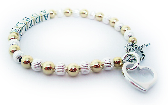 This Gold 1 -1 string bracelet is shown with a Twisted Toggle Clasp. They put Adele on thee bracelet and added an Open Heart Charm to their order.