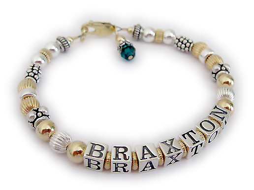 DBL-G6-1 string  This is a 1- bracelet with 1 name. Enter: BRAXTON This is a 1-string Gold NANA Name Bracelet with BRAXTON. They added May or Emerald Swarovski Crystal Birthstone Crystal Dangle charm and upgraded to a 14k gold-plated lobster claw clasp.