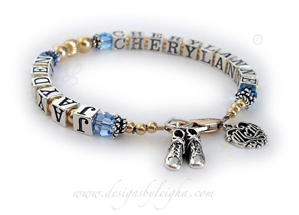 This is a 1- string / 2 name Gold Mom Bracelet with JAYDEN (Aquamarine or March), CHERYLANNE (Aquamarine or March). They added Baby Boy Bootie charm a Filigree MOM charm and a 14k gold-plated lobster claw clasp to their order.
