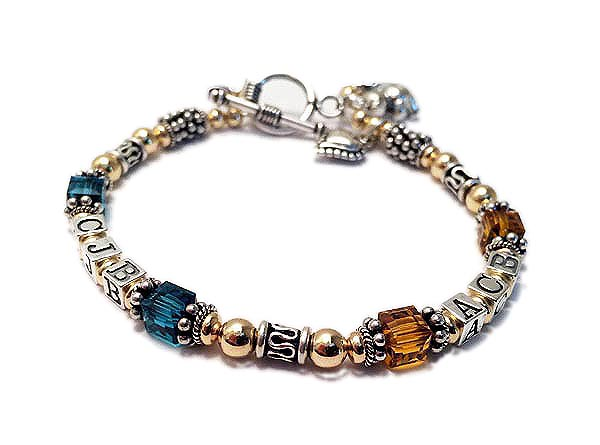 DBL-MB11-1string with 2 sets of initals ENTER: CJB/Teal, ACB/Gold This Gold & Bali Birthstone Monogram Bracelet is a 1 string bracelet with her kids' initials and favorite colors.