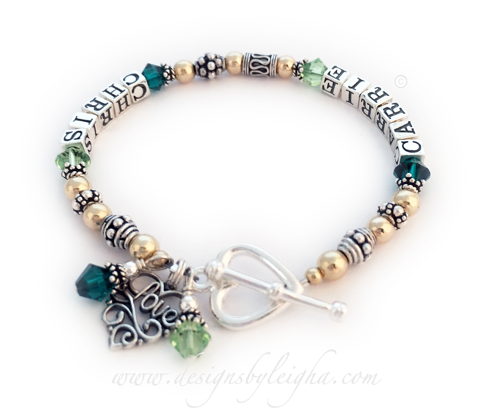 DBL-G7-1string   Enter: CLAIRE CHRIS / greens  Claire and Chris Gold Mother Bracelet with multiple names shown with options: They upgraded to a Heart Toggle clasp and added 3 charms: 2 Birthstone Crystal Dangles and a Filigree Love charm.