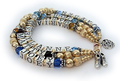Gold mothers bracelet with 6 names