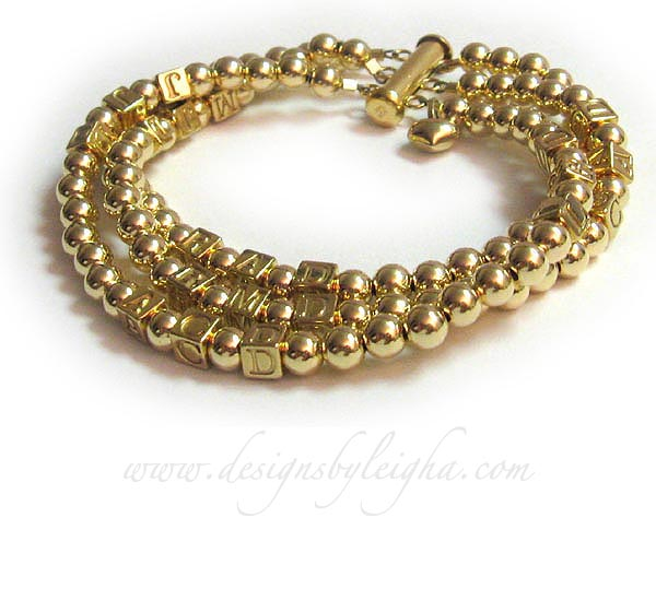 gold mothers bracelet with 7 sets of initials