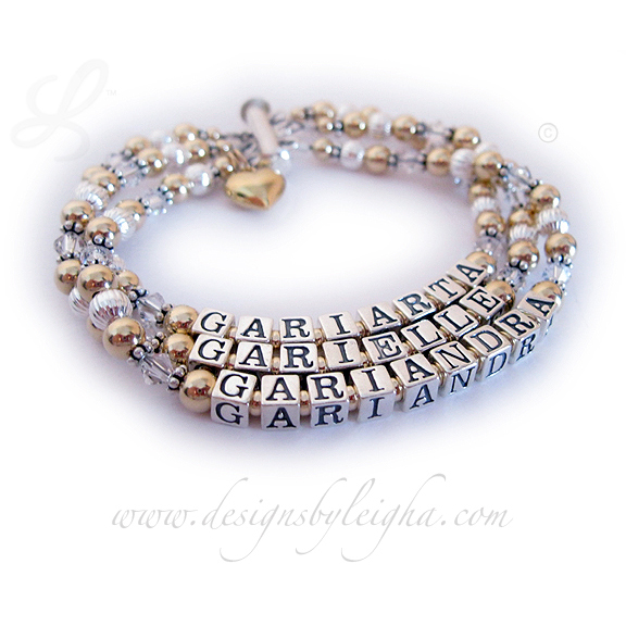 Item: DBL-G3-3 string bracelet Enter: GARIARTA/Apr - GARIELLE/Apr - GARIANDRA/Apr This Gold Mothers Birthstone Bracelet with Swarovski Crystals is a 3-string bracelet with 3 names: GARIARTA (April or Diamond Crystals) - GARIELLE (April or Diamond Crystals) - GARIANDRA (April or Diamond Crystals). They choose a 3-string slide clasp and added a Gold Puffed Heart Charm to their order.